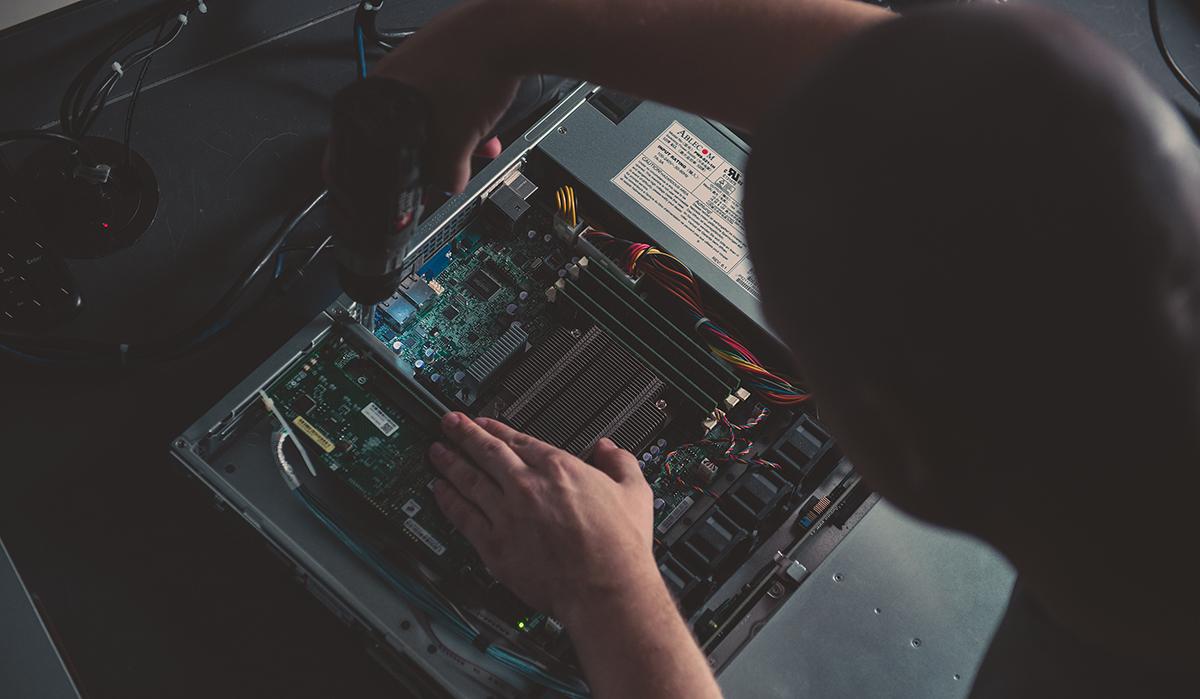 Image of a man building a server