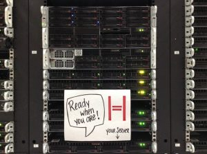 """server rack with a sticker saying """"Your server is ready when you are"""""""