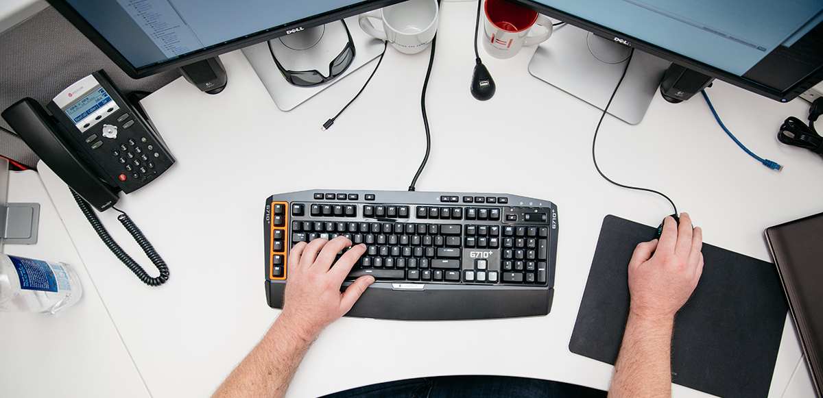 a pair of hands working a mouse and keyboard