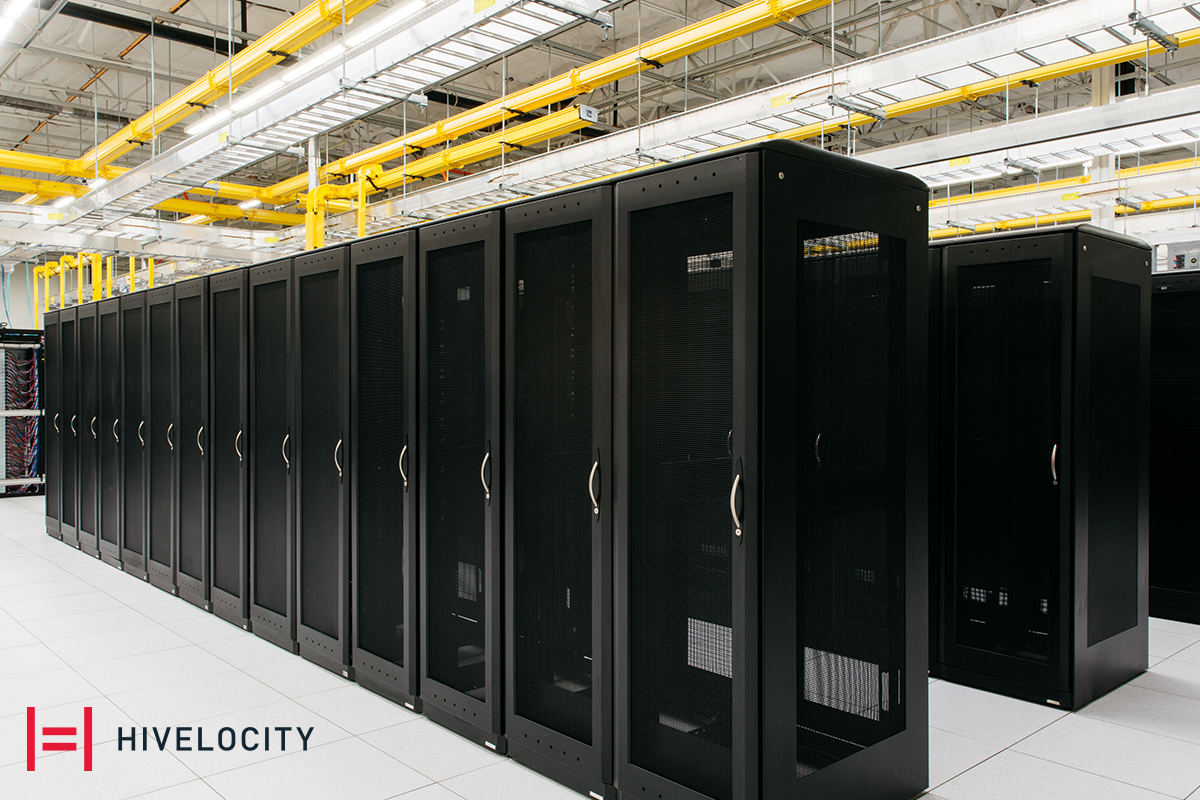 The Hivelocity logo next to rows of server cages ready to be filled