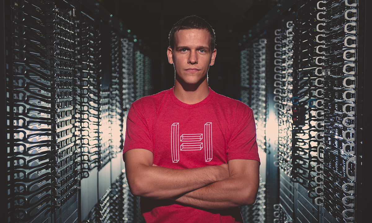 A Hivelocity employee standing in a server room filled with dedicated servers